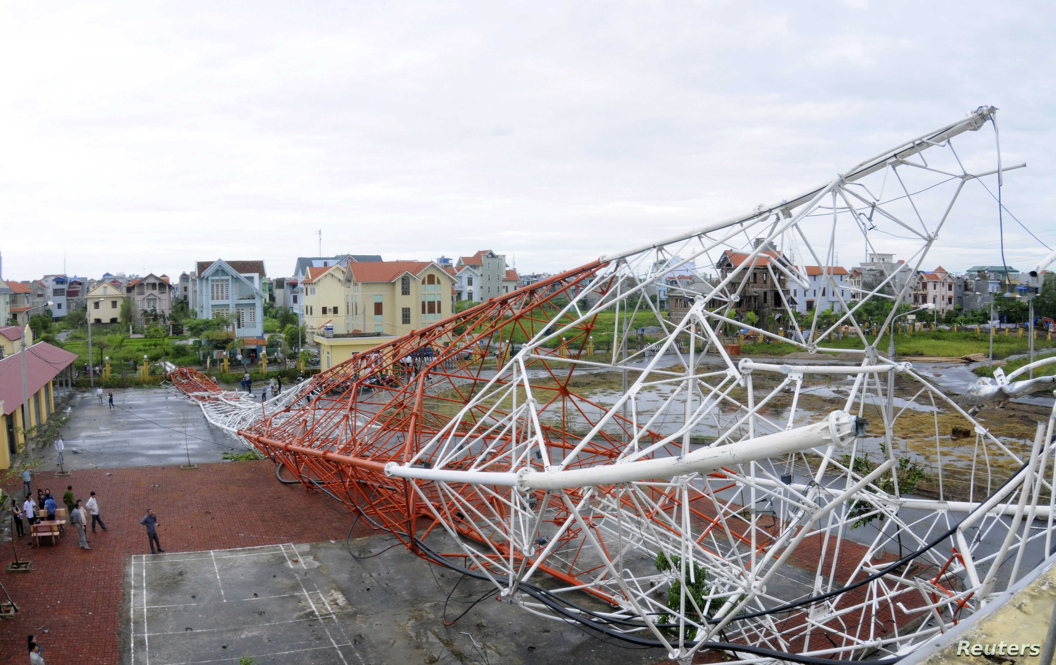 People look at the Nam Dinh television tower which collapsed due to Typhoon Son-Tinh in Nam Dinh city, 100 km (62 miles) south of Hanoi October 29, 2012.