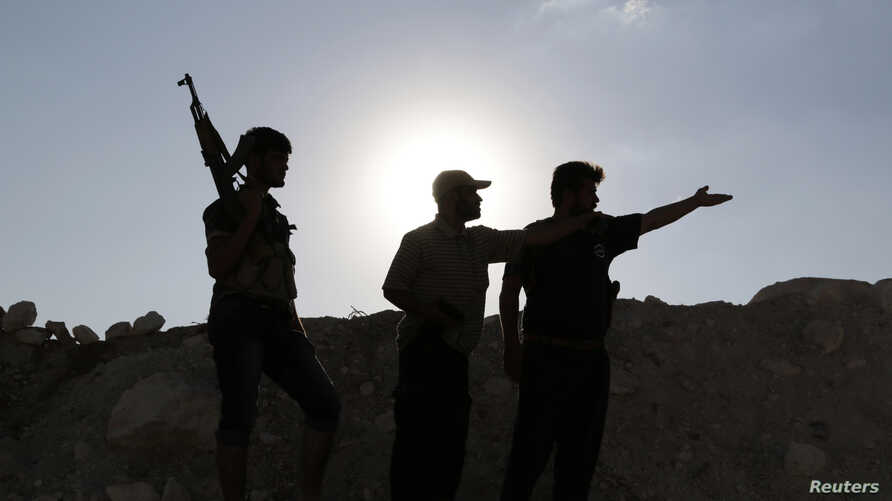 Armed Free Syrian Army fighters near Wadi Al-Dayf camp in the southern Idlib countryside, Sept. 14, 2014.