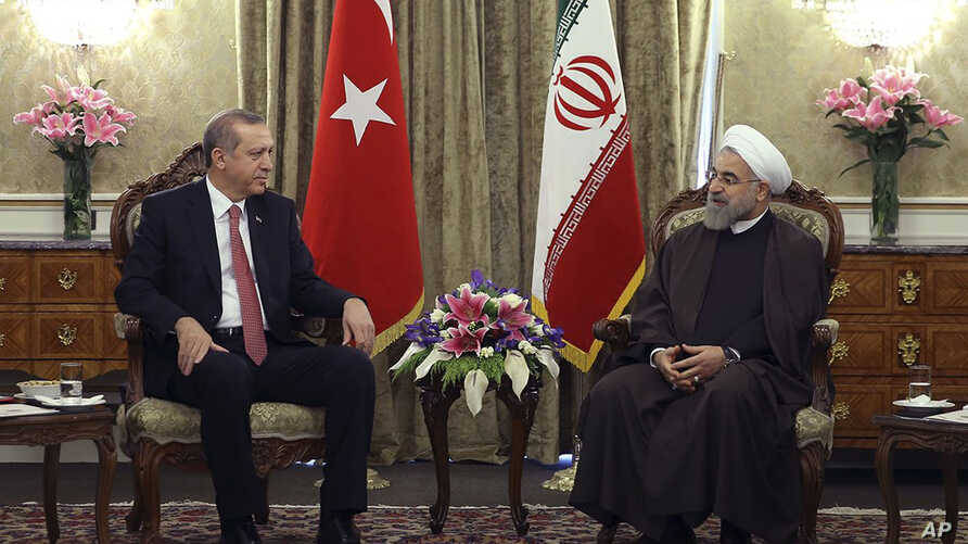 In this photo released by the official website of the office of the Iranian Presidency, Iran's President Hassan Rouhani, right, talks with his Turkish counterpart Recep Tayyip Erdogan at the Saadabad palace in Tehran, April 7, 2015.