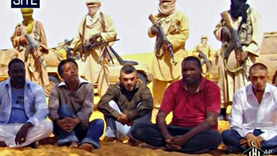 Image taken from video and provided by U.S.-based SITE Intelligence Group shows the first images of a group of foreign hostages working for a French energy company who were seized in Niger two weeks ago by an al-Qaida offshoot, according to the group