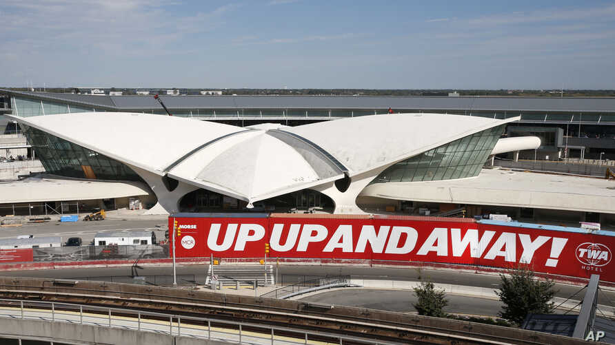 In this Oct. 10, 2017 photo, construction continues on the TWA Hotel at John F. Kennedy International Airport in New York. The hotel at the long-closed TWA Flight Center will conjure the glamour of air travel in 1962 when architect Eero Saarinen's je