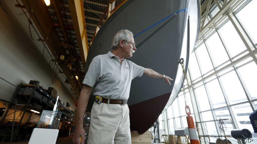 Bruce Harris, volunteer project coordinator, points out features of the hull of PT-305, a World War II patrol torpedo boat, which is being restored at the World War II Museum in New Orleans, March 8, 2016.
