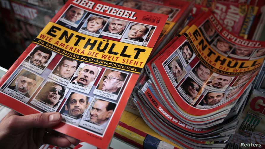 FILE - A customer buys an issue of 'Der Spiegel' magazine at a kiosk in Hamburg, Germany, Nov. 29, 2010. The publication pulled its reporter Hasnain Kazim out of Turkey amid signs he is no longer welcome there.