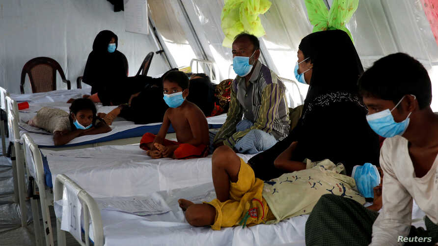 FILE - Rohingya refugees, who suffer from diphtheria, are treated at a Medecins Sans Frontieres (MSF) clinic near Cox's Bazar, Bangladesh, Dec. 18, 2017.
