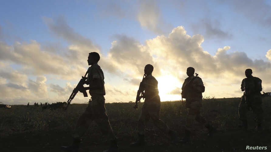 FILE - Somali army soldiers are seen near Barawe, Somalia, Oct. 4, 2014.