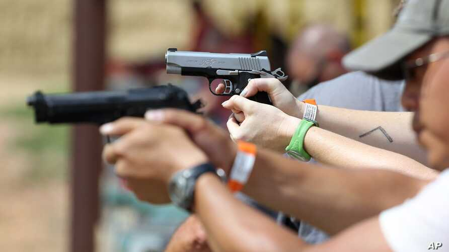 A judge overturned a prohibition on handguns in Washington, D.C., and the city is considering an appeal. Here, shooters practice with pistols at a gun range near Colorado Springs, Colo., July 20, 2014.