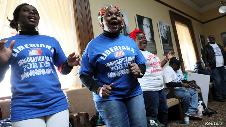 FILE - Liberian activists sing and dance prior to their Deferred Enforced Departure (DED) immigration status rally at the Minnesota State Capitol in St. Paul, Minnesota, Feb. 22, 2019.