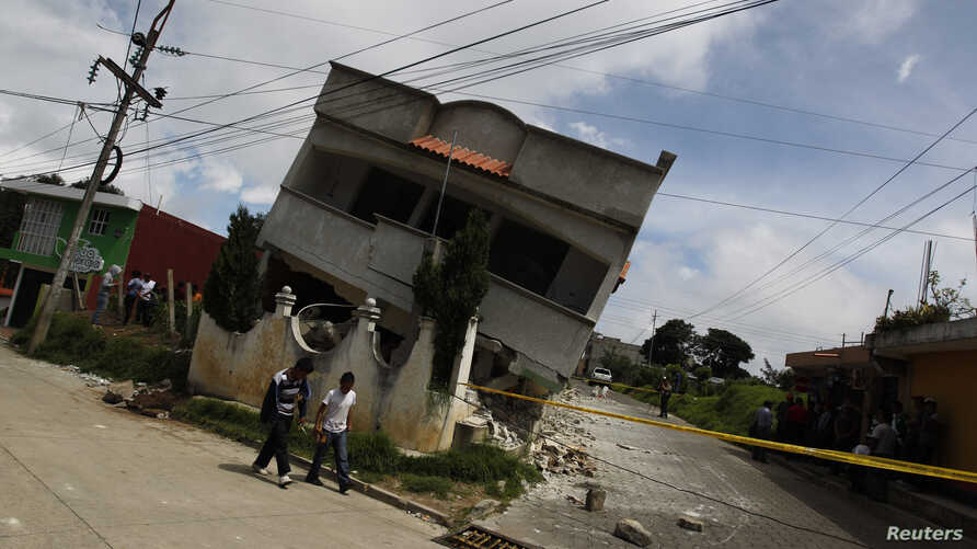 An earthquake-damaged house is pictured in the San Marcos region, in the northwest of Guatemala, July 7, 2014.