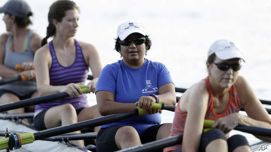 FILE - Manasi Gopala, second from right, rows during her sculling class at Lake Wheeler in Raleigh, N.C. on August 30, 2016. When Gopala immigrated to America, she finally got the chance to row crew.