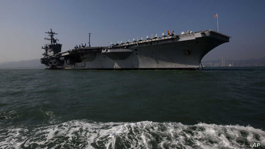 "The aircraft carrier USS Carl Vinson is anchored in Hong Kong water, Dec. 27, 2011. The carrier currently is headed towards the Korean Peninsula as a ""prudent measure."""