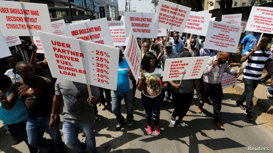 FILE - Kenyan taxi drivers signed up to ride-hailing service Uber chant slogans and dance along the streets during a strike after the company slashed prices in the face of growing competition from similar local firms in Kenya's capital Nairobi, Aug.