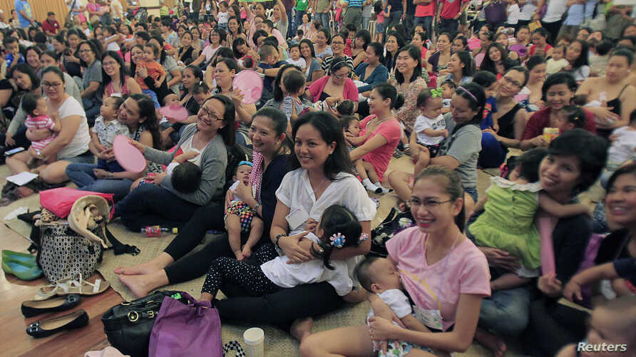 Some 170 mothers breastfeed their children during a mass breastfeeding event inside a military headquarters in Taguig City, metro Manila, August 2, 2014.