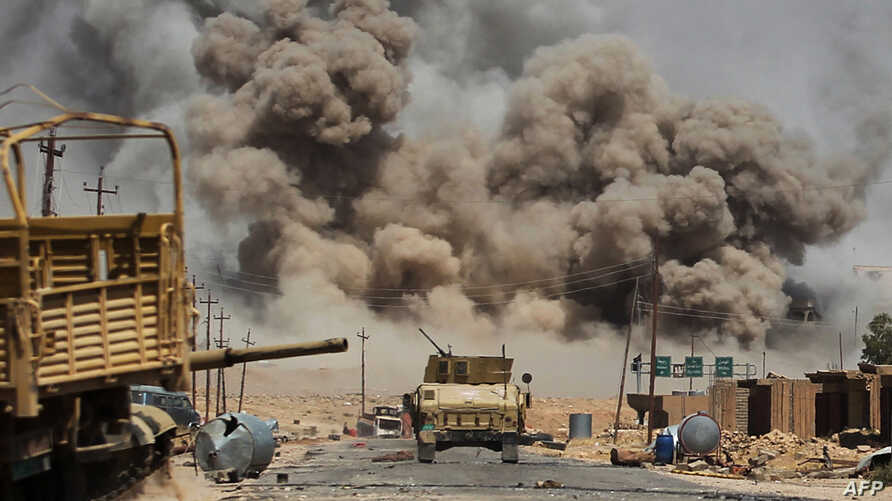 Smoke billows as Iraqi forces advance towards Al-Ayadieh village, the last remaining active front line near Tal Afar, during an operation to retake the city from the Islamic State (IS) group on August 29, 2017.