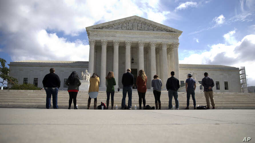 "FILE - Members of ""Bound 4 Life"" gather in front of the Supreme Court in Washington to protest the ideology of abortion, Oct. 5, 2015."