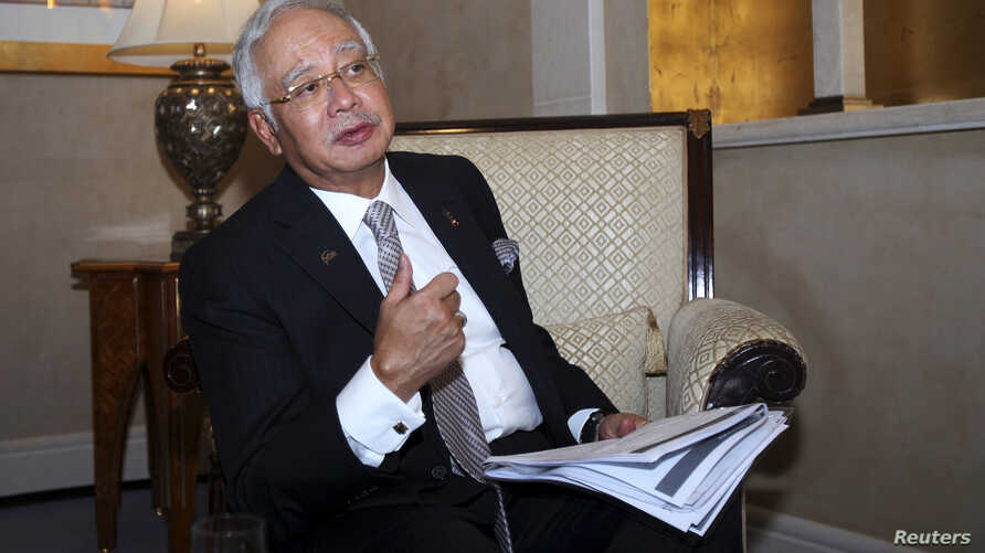 Malaysia's Prime Minister Najib Razak speaks to Reuters during the 10th World Islamic Economic Forum in Dubai Oct. 28, 2014.