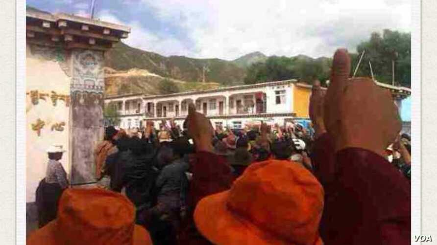 Tibetan protesters in Denma give the thumbs up sign during a protest in August.