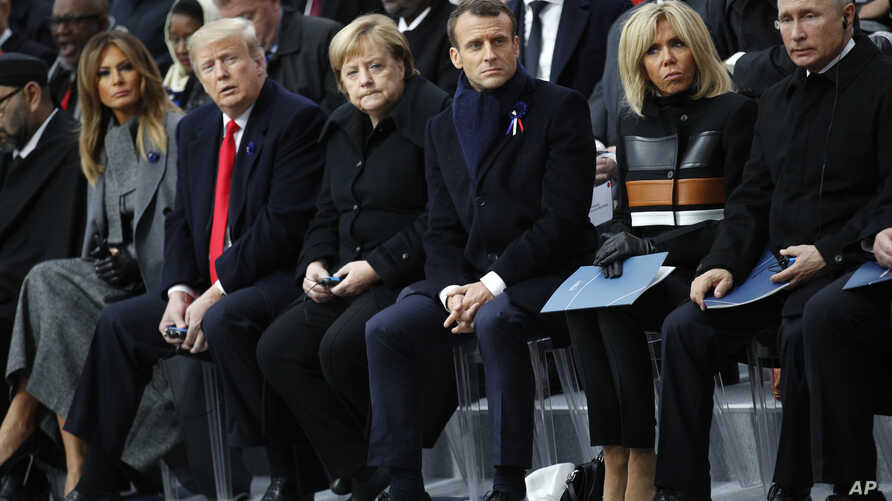 France WWI Centennial U.S President Donald Trump, second left, and first lady Melania Trump, left, German Chancellor Angela Merkel, third left, French President Emmanuel Macron and his wife Brigitte, Russian President Vladimir Putin, right, attend ce...