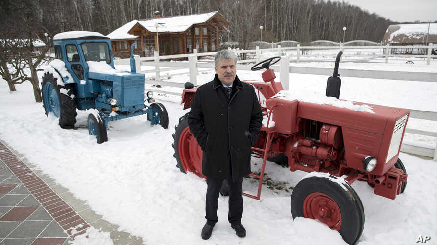 he Communist Party's candidate for the 2018 Russian presidential election Pavel Grudinin poses for a picture with old Soviet-made tractors, at Lenin state farm outside Moscow, Russia, Jan. 26, 2018.