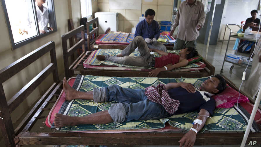 This Aug. 26, 2009 photo shows patients suffering from malaria being treated at the hospital in Pailin, Cambodia.