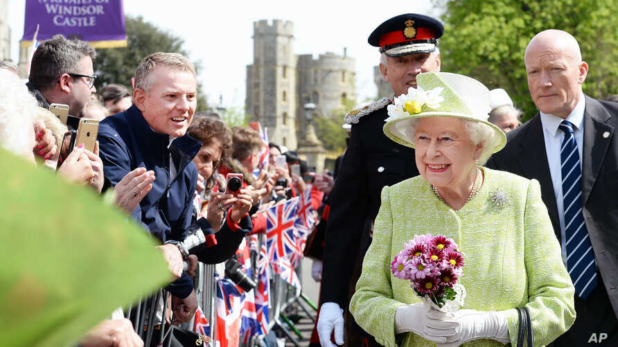 Queen Elizabeth II meets well wishers during a walkabout close to Windsor Castle as she celebrates her 90th birthday, in Berkshire, England, April 21, 2016.