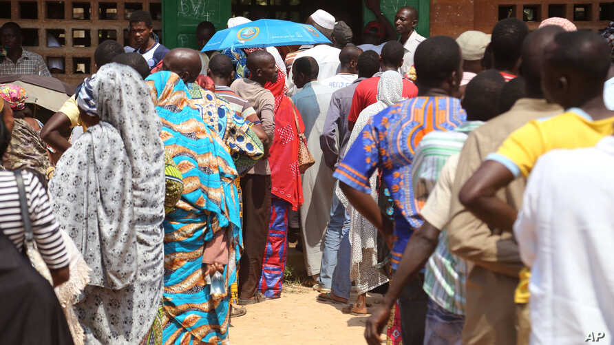 People stand in line to cast their ballots, during elections in Bangui, Central African Republic, Wednesday, Dec. 30, 2015.