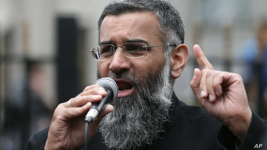 FILE - Anjem Choudary, a British Muslim social and political activist and spokesman for Islamist group, Islam4UK, speaks following prayers at the Central London Mosque in Regent's Park, London, April 3, 2015.