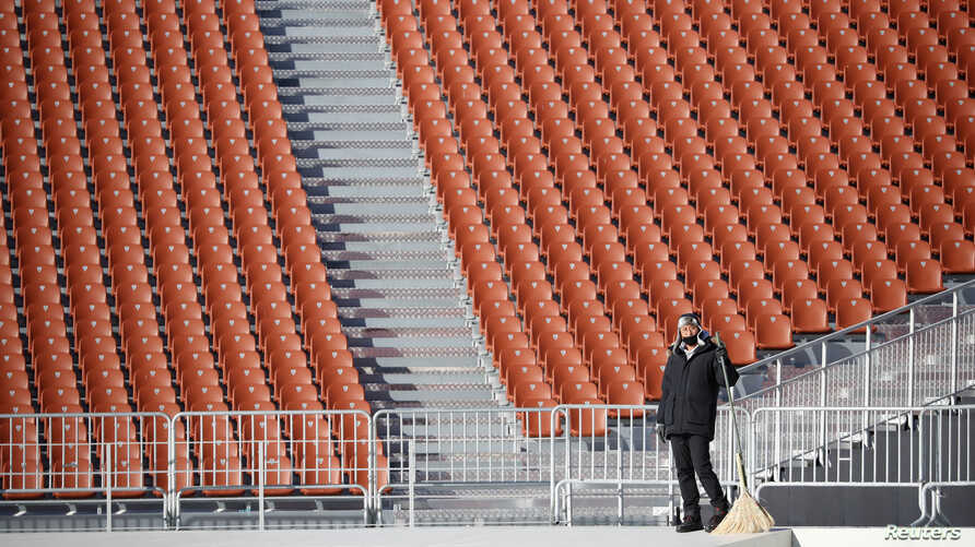 A worker is seen at the Olympic Stadium, venue for the opening and closing ceremonies of the 2018 Pyeongchang Winter Olympic Games in Pyeongchang, South Korea, Dec. 12, 2017.