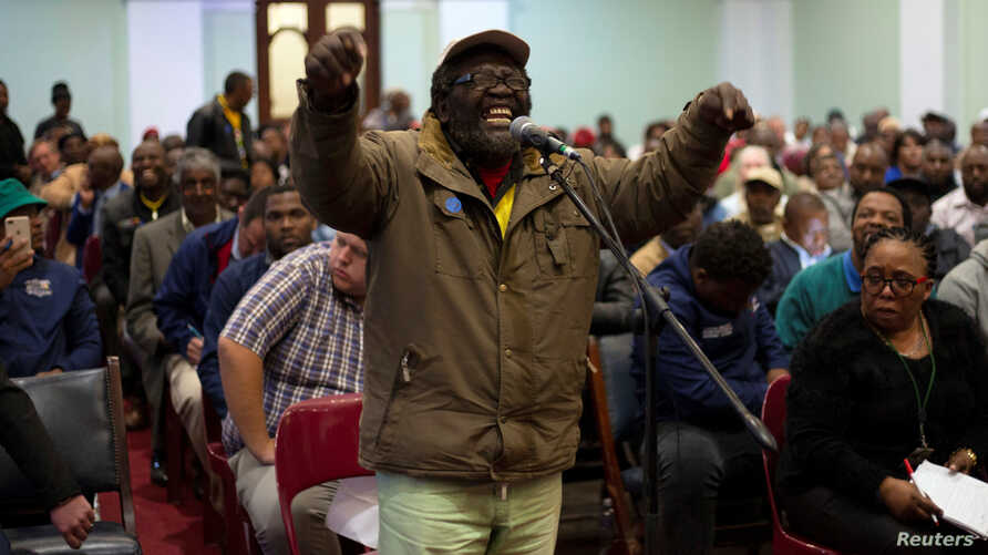 FILE - A man speaks as the Constitutional Review Committee holds public hearings regarding expropriation of land without compensation in Pietermaritzburg, South Africa, July 20, 2018.