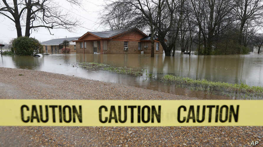 Caution tape closes off this neighborhood in Drew, Miss., Friday, March 11, 2016, as floodwaters have affected areas in the Delta. The flooding has affected the Delta to varying degrees. Additional rain is expected to continue through Saturday.