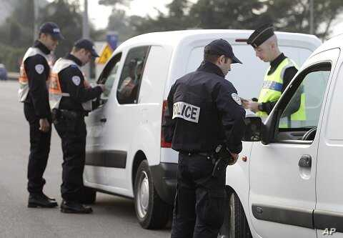 French policemen check identity papers and cars in La Turbie, southeastern France, near the Franco-Italian border, in spite of the EU's passport-free zone Schengen, as security measures are taken ahead of the G20 Summit of Cannes, October 31, 2011.
