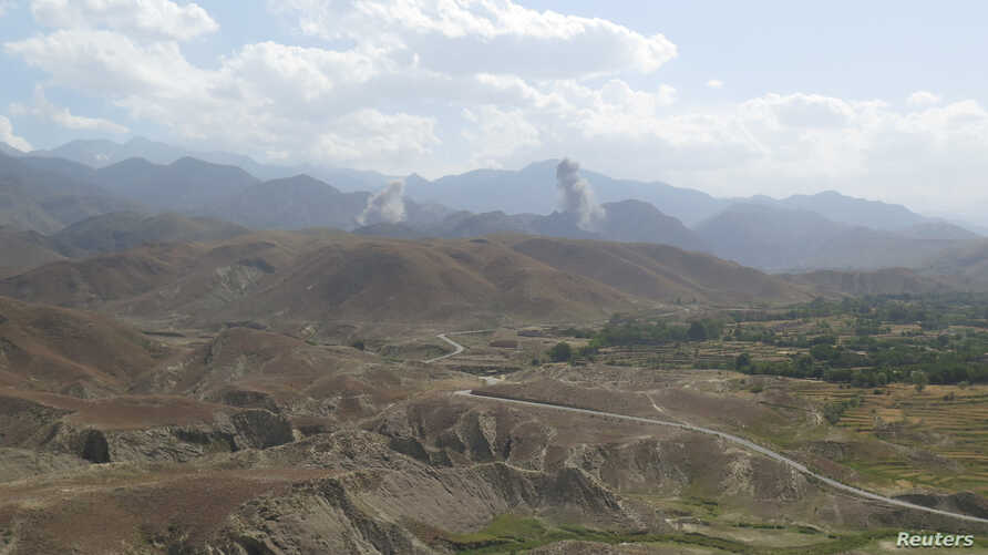 FILE - Smokes rises after а U.S. airstrike hits the site o