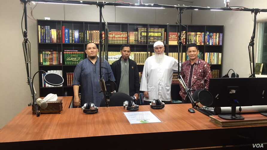 The staff at Hang Radio, a Salafi Islam radio station on the Indonesian resort island of Batam. (K. Varagur/VOA)