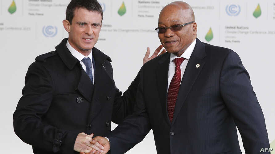 South Africa's President Jacob Zuma (R) is greeted by France's Prime Minister Manuel Valls as he arrives for the COP21 United Nations Climate Change Conference on Nov. 30, 2015 in Le Bourget, outside Paris.