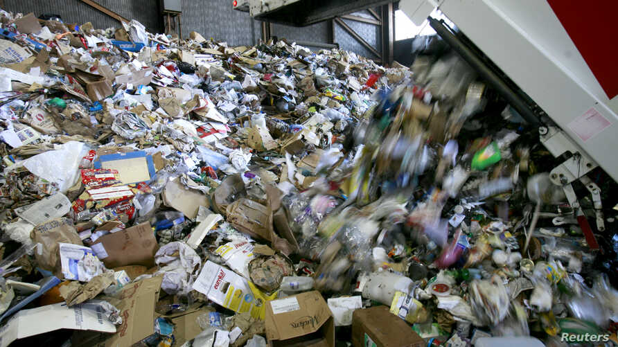 Refuse is unloaded at Recology in San Francisco, Calif., Nov. 2, 2009. Since Jan. 1, when China banned imports of some recyclables, much of what the U.S. recycles has no place to go.