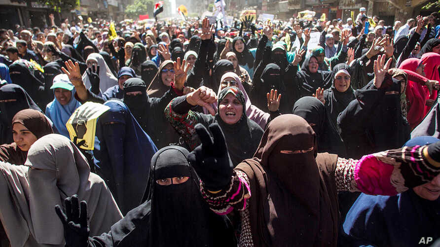 Supporters of the ousted Egypt's ousted President Mohamed Morsi march in Cairo, March 28, 2014.