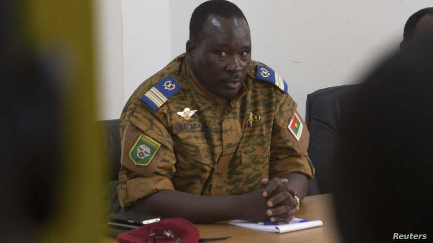Lieutenant Colonel Isaac Zida meets with opposition leaders in Ouagadougou, capital of Burkina Faso, Nov. 2, 2014.