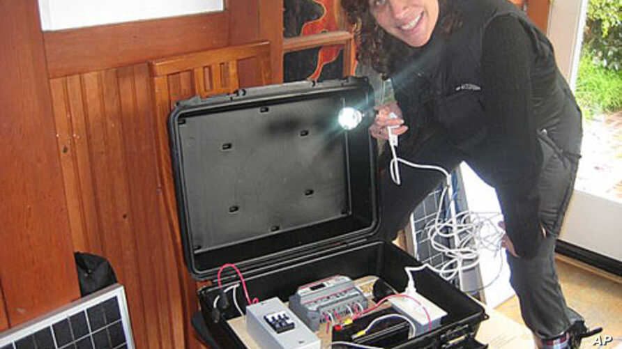 Dr. Laura Stachel with a 'solar suitcase,' which powers two overhead LED lighting, charges walkie-talkies and cell phones and includes LED headlamps that come with their own rechargeable batteries.