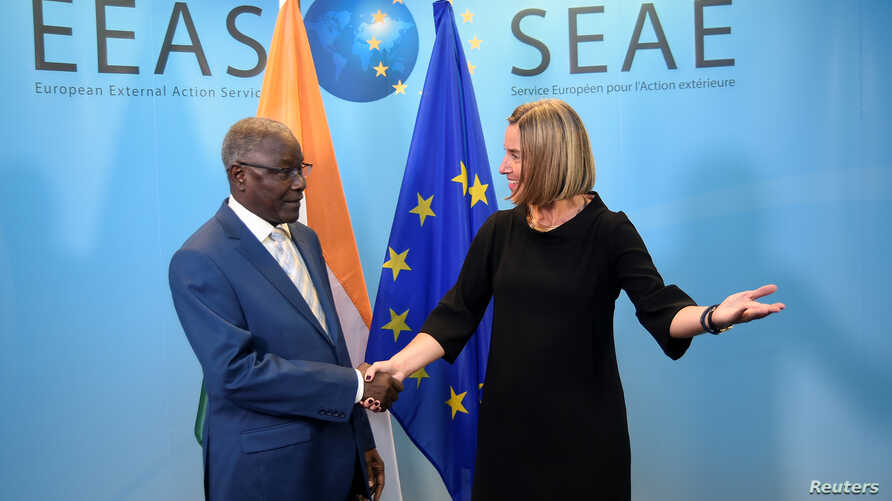 EU High Representative for Foreign Affairs Federica Mogherini welcomes Niger's Foreign Minister Kalla Ankourao before a G-5 Sahel Ministerial meeting at the EU headquarters in Brussels, Belgium, June 18, 2018.
