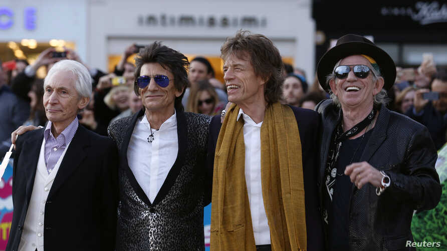 """Members of the Rolling Stones (L-R) Charlie Watts, Ronnie Wood, Mick Jagger and Keith Richards arrive for the """"Exhibitionism"""" opening night gala at the Saatchi Gallery in London, April 4, 2016."""
