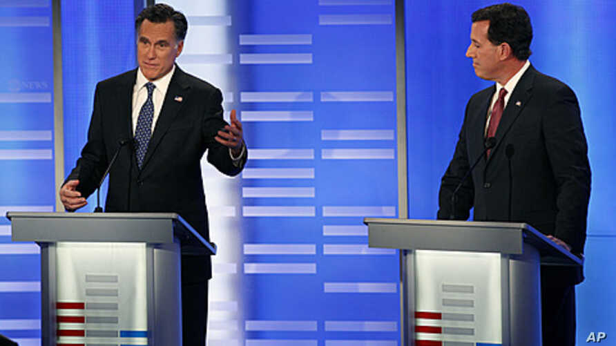 Former Massachusetts Gov. Mitt Romney, left, and former Pennsylvania Sen. Rick Santorum during a Republican presidential candidate debate at Saint Anselm College in Manchester, New Hampshire, January 7, 2012.