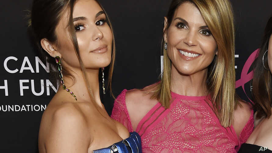 """In this Feb. 28, 2019 file photo, actress Lori Loughlin poses with her daughter Olivia Jade Giannulli, left, at the 2019 """"An Unforgettable Evening"""" in Beverly Hills, Calif."""