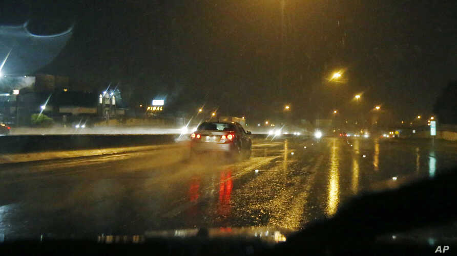 FILE - Cars move on Interstate 55 North as temperatures start to drop in Jackson, Miss. In north Texas and Arkansas, authorities are bracing for more flooding from rain-swollen rivers.