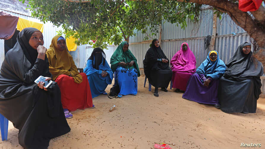 Family members mourn Mohamed Mohamud, who they say was killed in an attack by Somali forces supported by U.S. troops in Bariire village in Mogadishu, Somalia, Aug. 29, 2017.