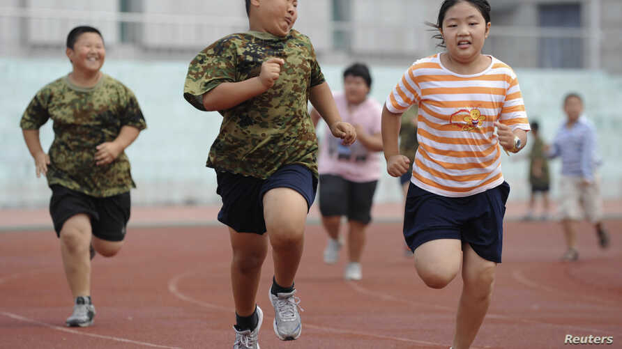 FILE - Children exercise during a weight-losing summer camp in Shenyang, Liaoning province, China.