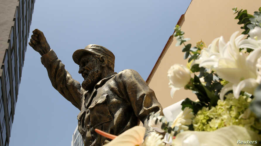 At the Cuban embassy in Lima, Peru, flowers have been placed next to a statue of Cuban revolutionary leader Fidel Castro following the announcement of his death, Nov. 28, 2016.