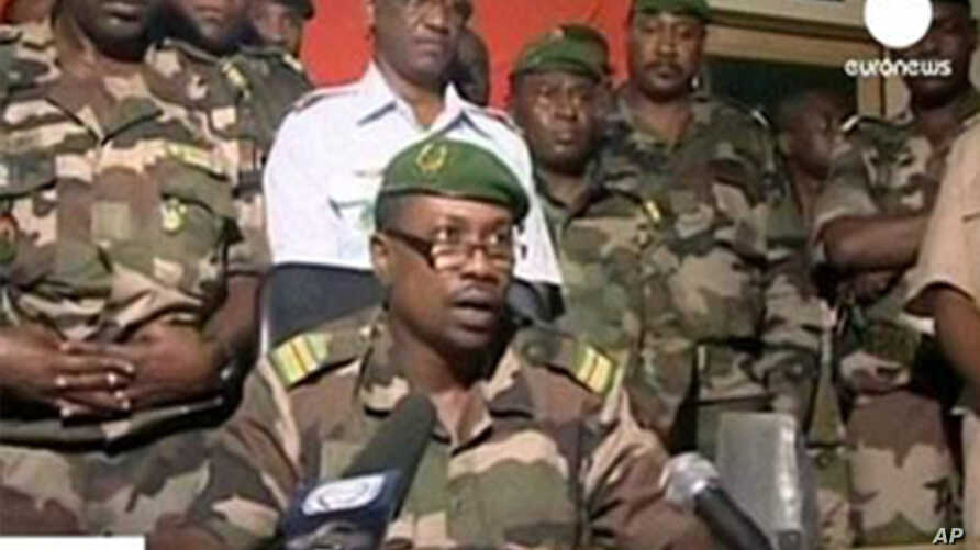 TV frame grab shows Colonel Gokoye Abdul Karimou, spokesman for the Niger millitary junta delivering a televised statement in Niamey, 19 Feb 2010