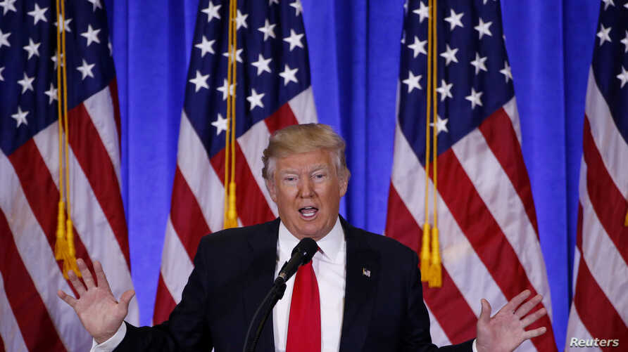 FILE - U.S. President-elect Donald Trump speaks during a news conference in the lobby of Trump Tower in New York, Jan. 11, 2017.