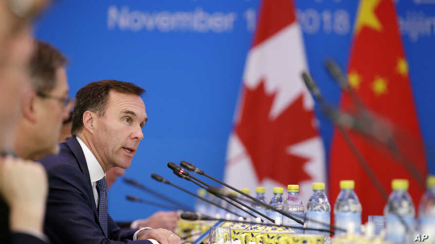 FILE - Canadian Finance Minister Bill Morneau speaks at the first China-Canada economic and financial strategy dialogue in Beijing, Nov. 12, 2018.