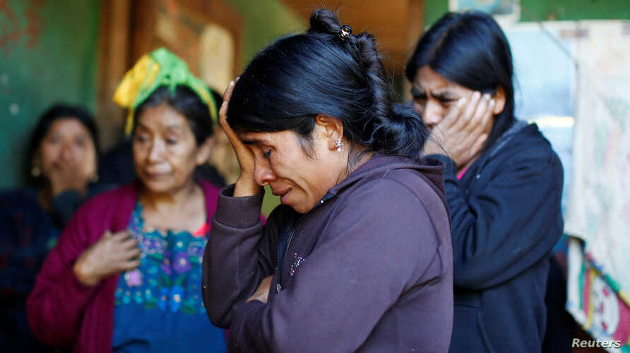 Catarina Alonzo, center, mother of Felipe Gomez Alonzo, a 8-year-old boy detained alongside his father for illegally entering the U.S., who fell ill and died in the custody of U.S. Customs and Border Protection (CBP), reacts at her home in the villag