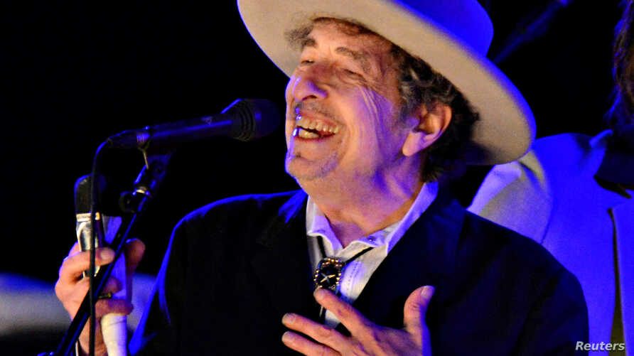 FILE - U.S. musician Bob Dylan performs during the second day of The Hop Festival in Paddock Wood, Kent, June 30, 2012.